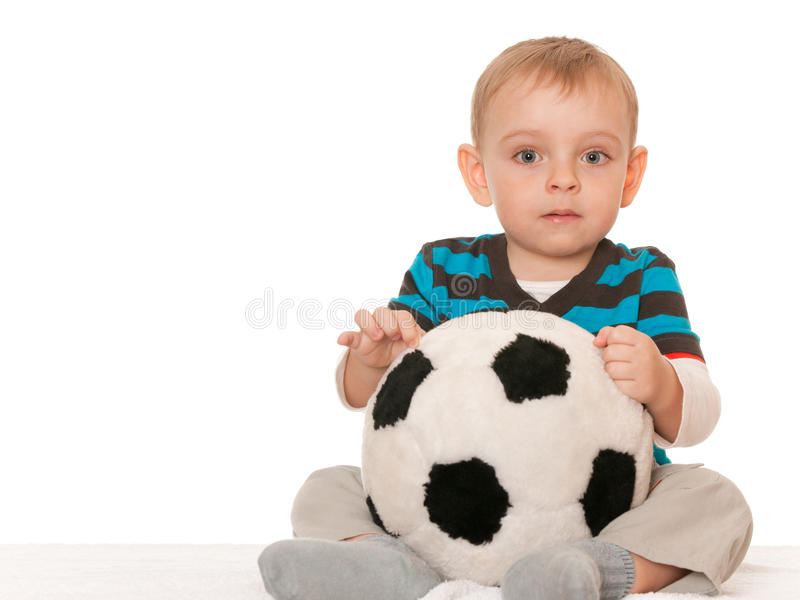 Little boy with a big toy ball royalty free stock image