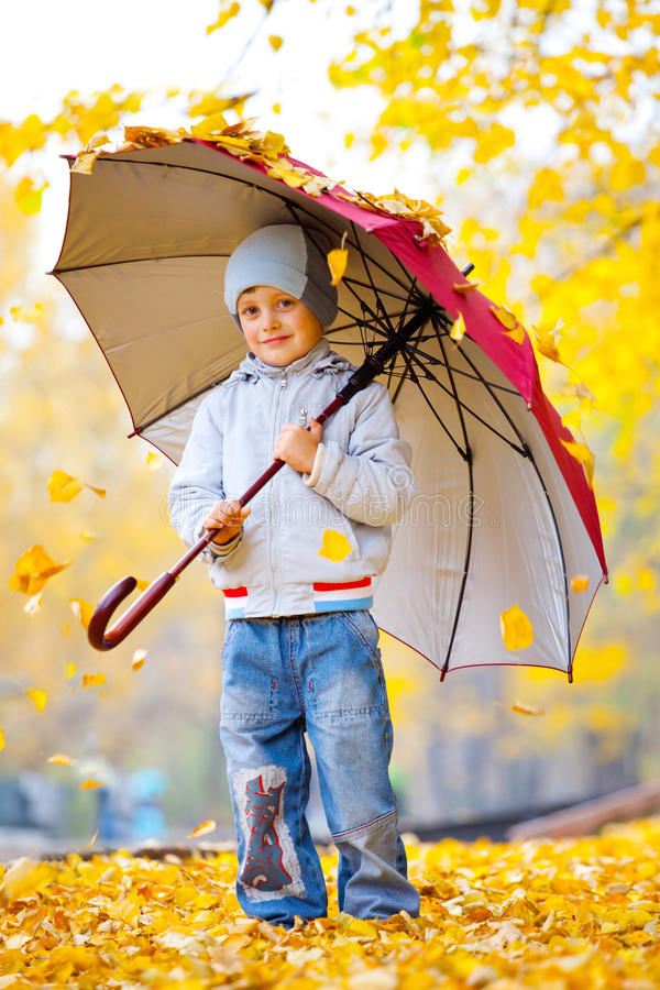 Little boy with big umbrella royalty free stock images