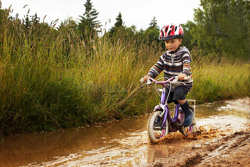 Little boy on bike stock image