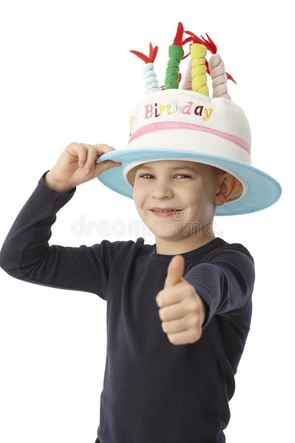 Little boy in birthday hat smiling happy stock images