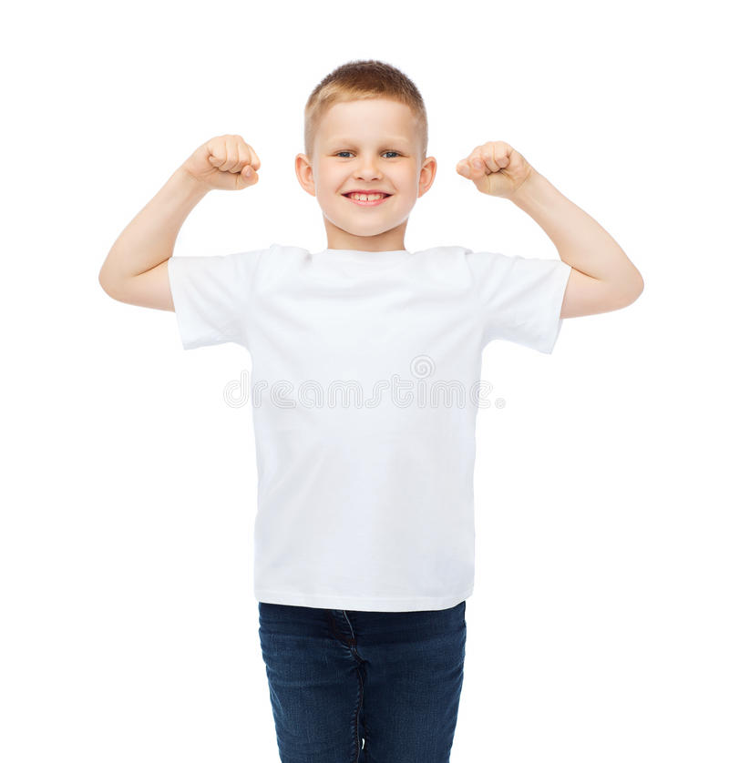 Little boy in blank white t-shirt showing muscles. T-shirt design, strength, health, sport and fitness concept - little boy in blank white t-shirt showing stock photos