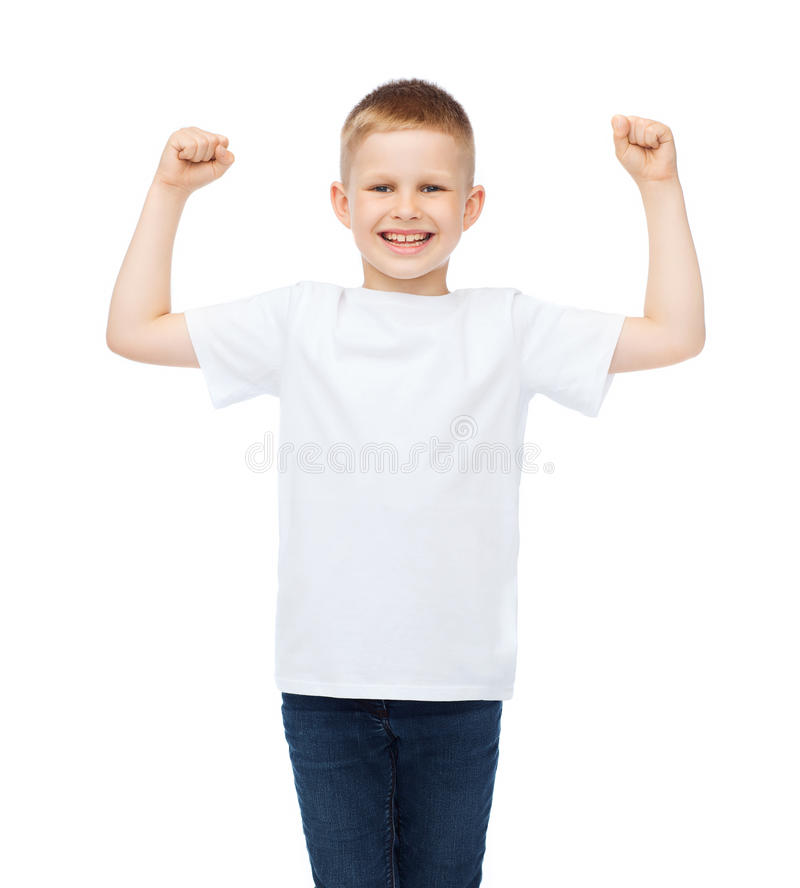 Little boy in blank white t-shirt showing muscles. T-shirt design, strength, health, sport and fitness concept - little boy in blank white t-shirt showing royalty free stock photo