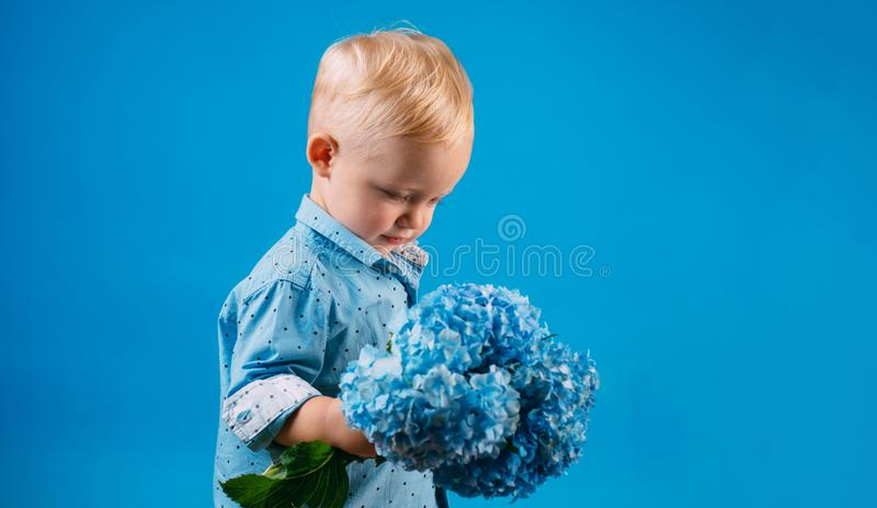 Little boy at blooming flower. Childrens day. Small baby boy. New life concept. Spring holiday. Summer. Mothers or royalty free stock photography