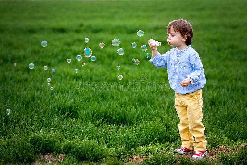 Little Boy Blowing Soap Bubbles Stock Photo