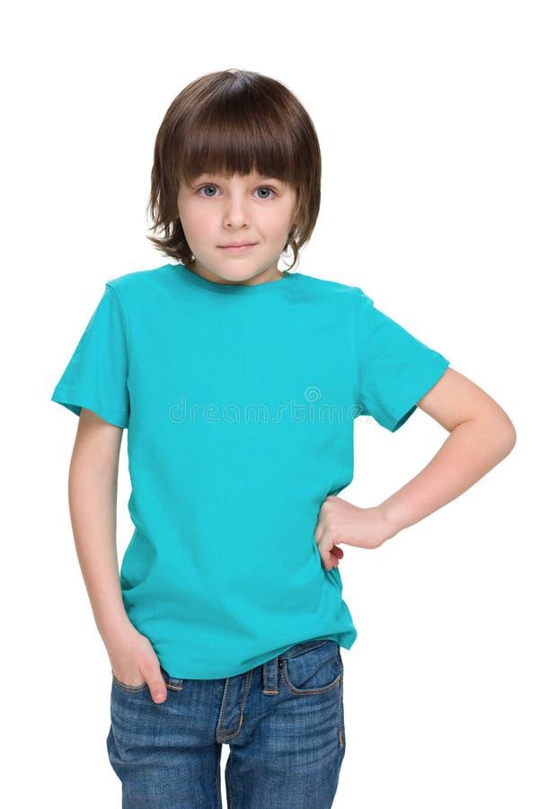 Little boy in a blue shirt stock photo