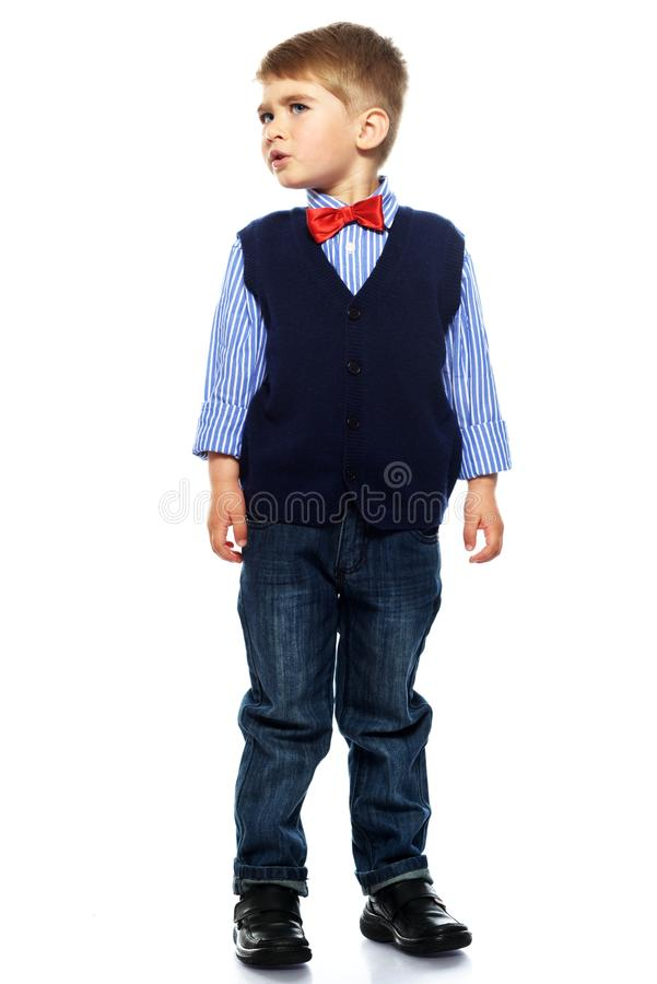 Little boy in blue vest. With red bow tie isolated on white background royalty free stock photo