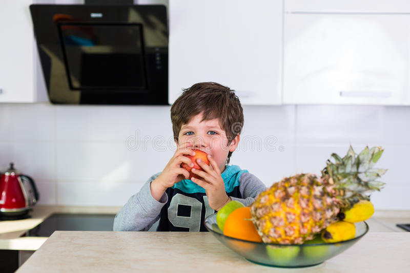 Little boy with a bowl of fresh fruits stock photo