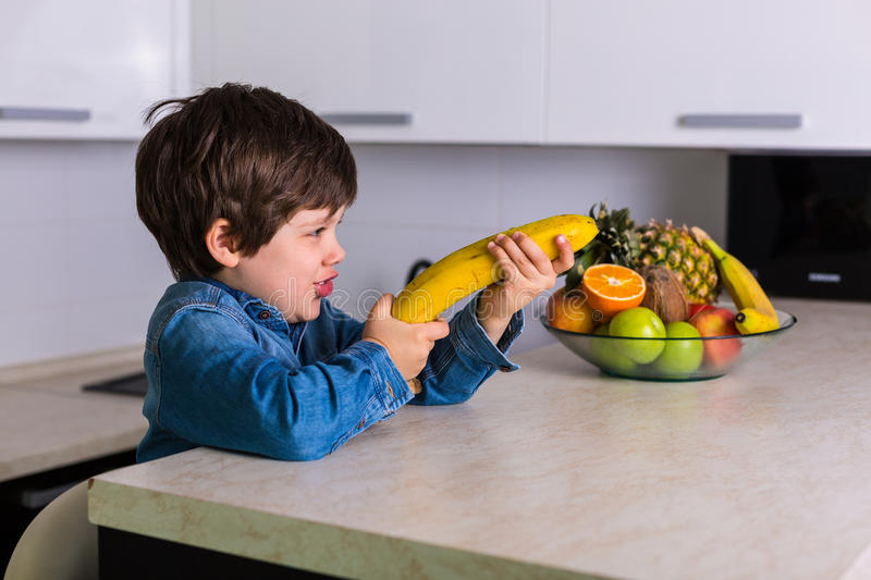 Little boy with a bowl of fresh fruits royalty free stock photography