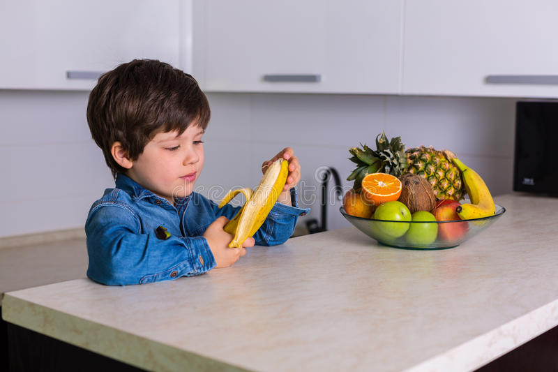 Little boy with a bowl of fresh fruits royalty free stock photos