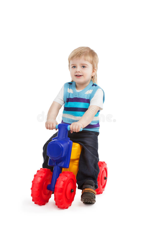 Little boy in the bright bike. Studio shot on white background stock images