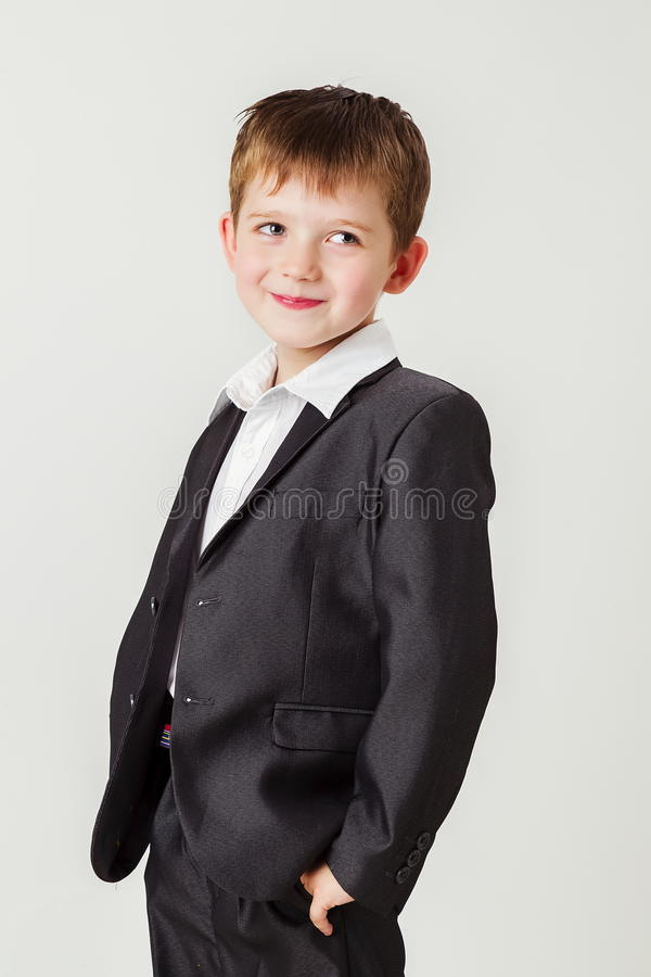 Little boy in a business suit royalty free stock image