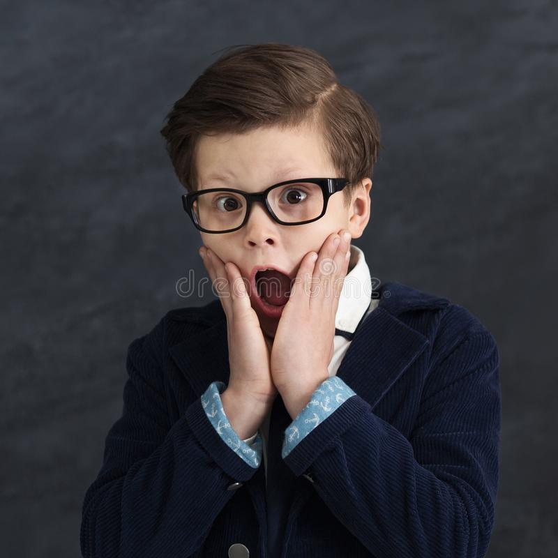 Little boy in business suit with shocked expression stock photography