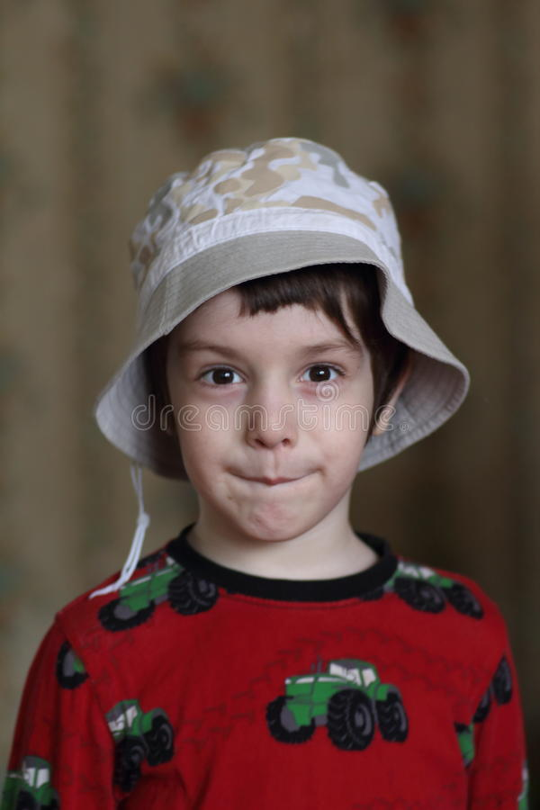 A little boy in a cap stock image