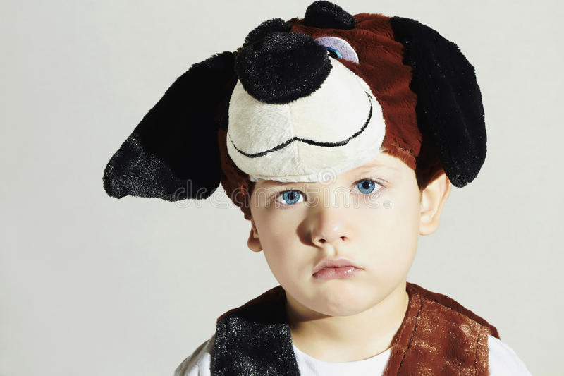 Little Boy.Carnival Dog Costume.Kids.Masquerade.Sad Child.Halloween. Little Boy don't want to be a dog.Carnival Dog Costume.Kids. Masquerade.Unusual Uniform.Sad stock photos