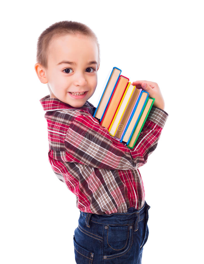 Little boy carrying books stock photos