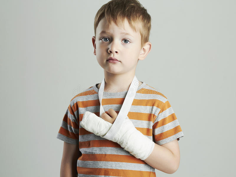Little boy in a cast.child with a broken arm.accident. Little boy in a cast.child with a broken arm.kid after accident royalty free stock photos