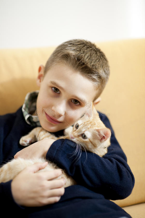Little boy with cat. Little boy with his cat royalty free stock images
