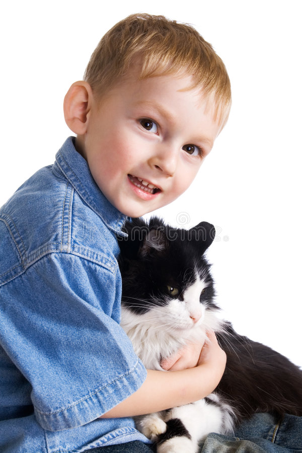 Little boy and cat. Little boy and fluffy cat royalty free stock image