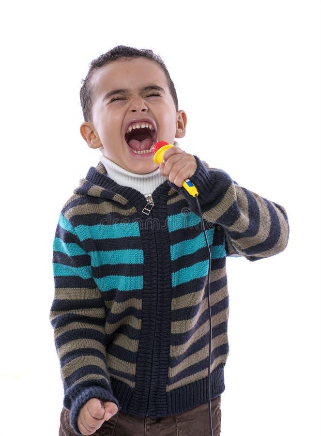 Little Boy chantant fort images libres de droits