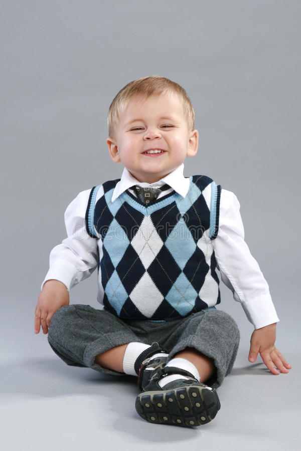 Little Boy In A Checkered Sweater Royalty Free Stock Photo