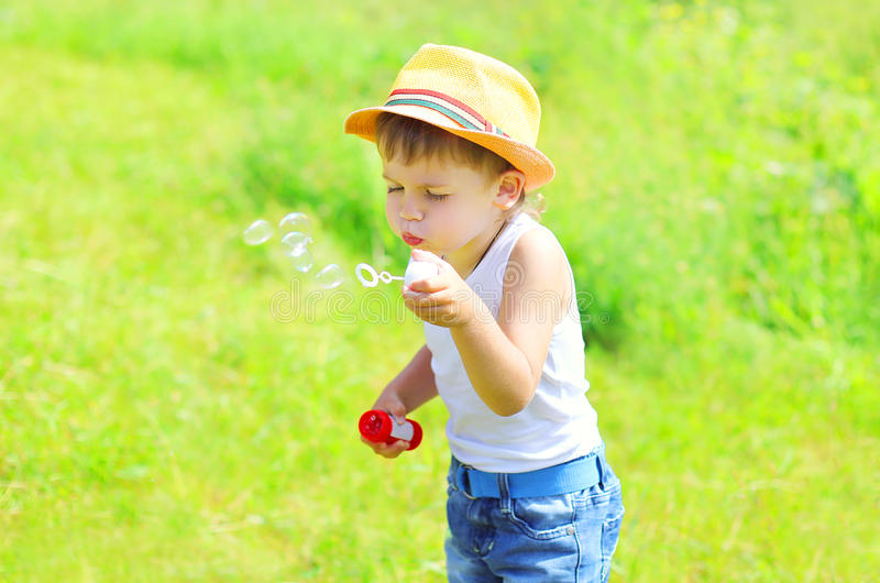 Little boy child blowing soap bubbles outdoors royalty free stock photos