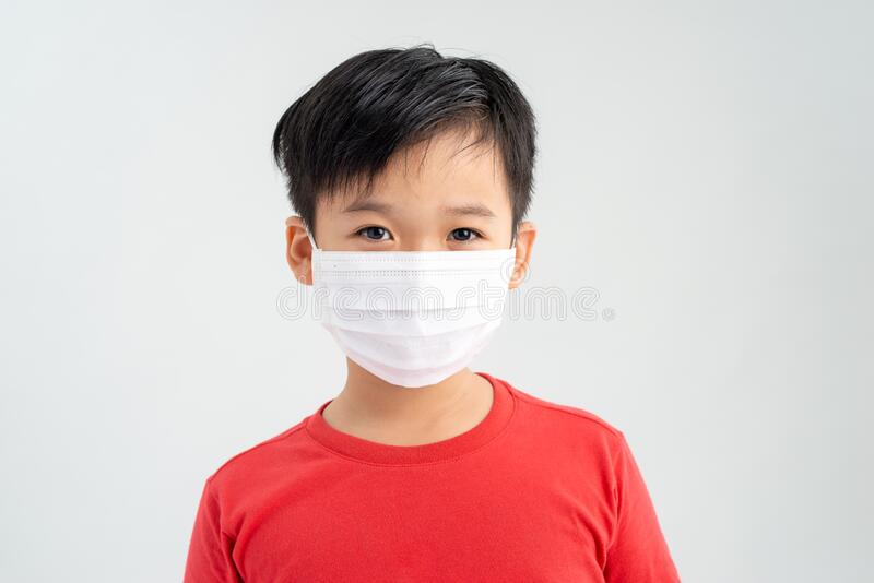 Little boy, a child in a medical mask on a white background. The concept of an epidemic, influenza, protection from disease,. Vaccination royalty free stock photo