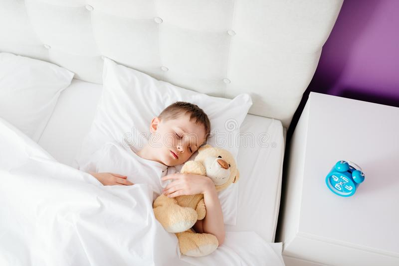 Little boy child sleeping in bed royalty free stock photos