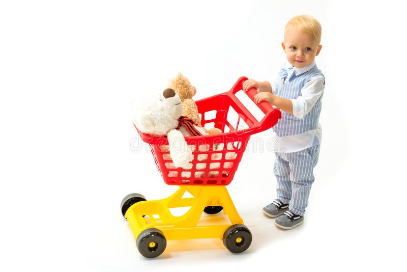 Little boy child in toy shop. savings on purchases. shopping for children. little boy go shopping with full cart. happy. Childhood and care. Pleased with choice royalty free stock photo