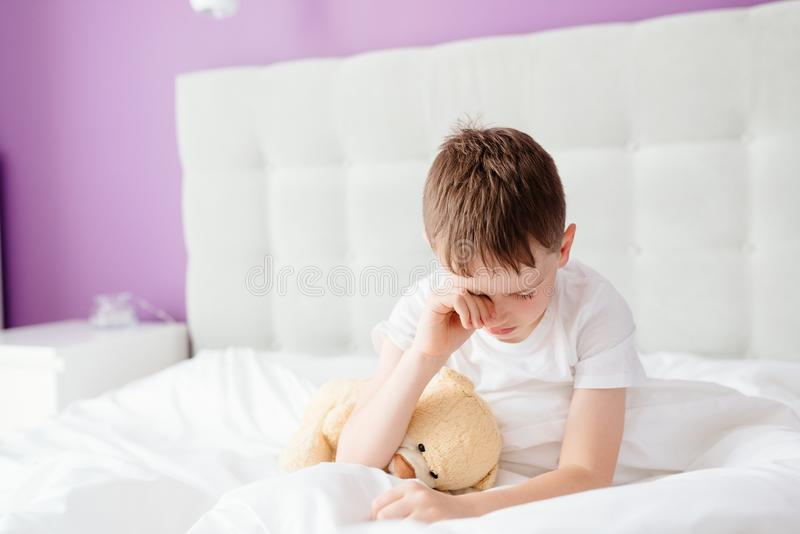 Little boy child waking up at the morning stock photography