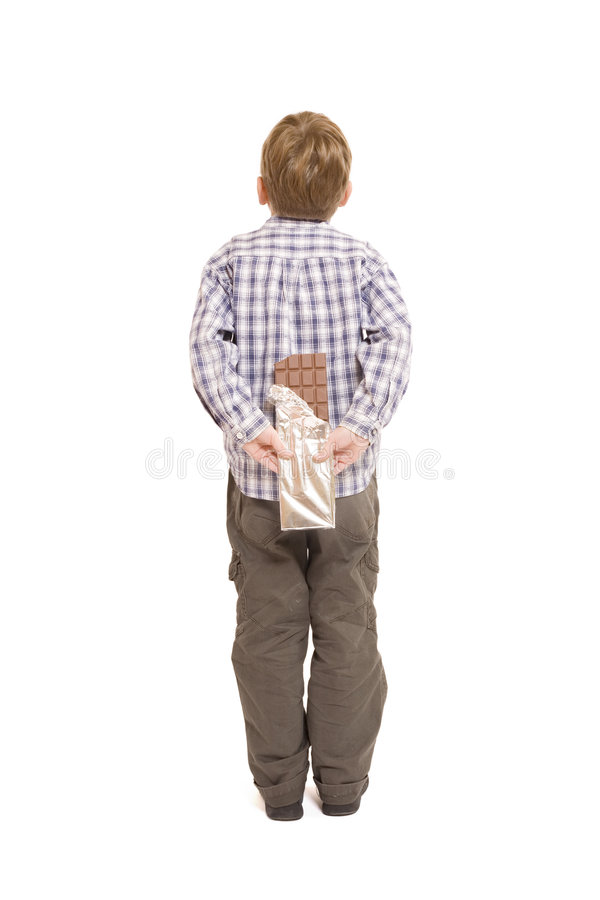 Little boy and chocolate stock photography