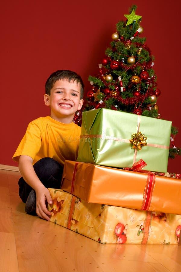 Little boy with christmas gift stock photo