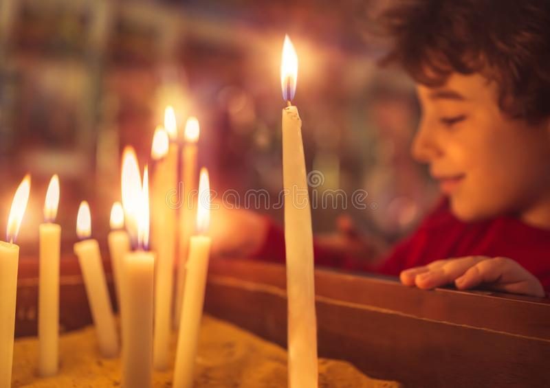 Little boy in the church on Easter stock photo
