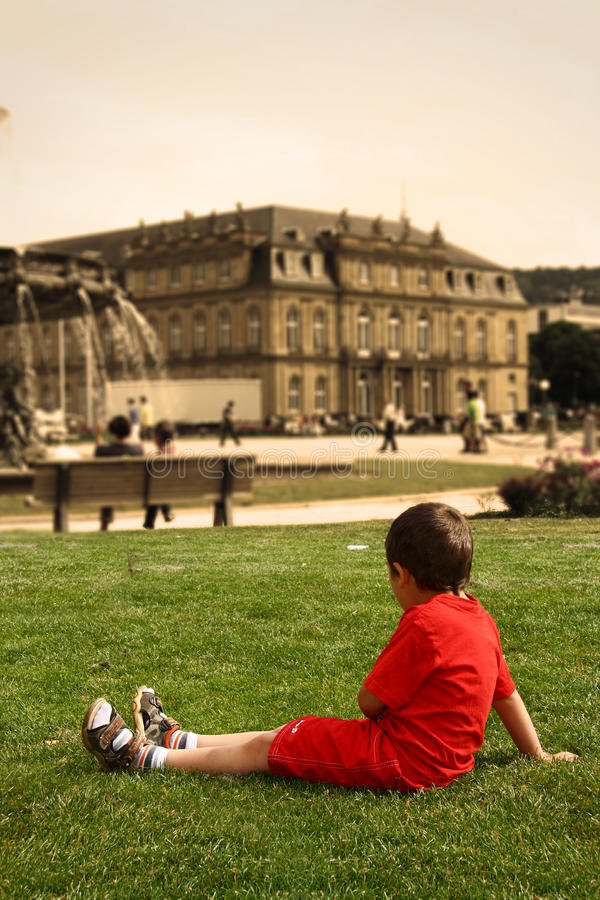 Download Little Boy In The City Center On The Grass Stock Image - Image: 20193879