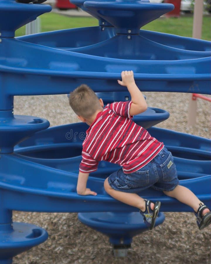 Little boy climbing royalty free stock photos
