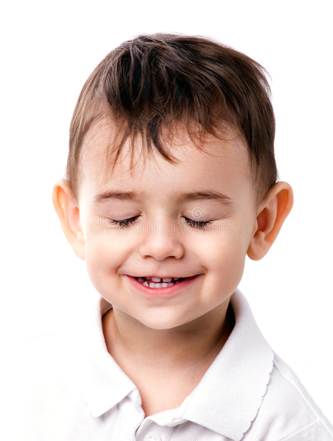 Little boy with closing eyes. Close-up portrait of a smiling little boy with closing eyes on white background stock photos