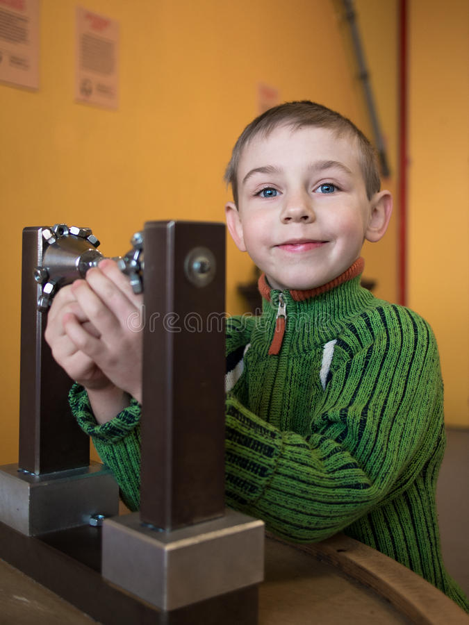 Little boy collects constructor royalty free stock photography