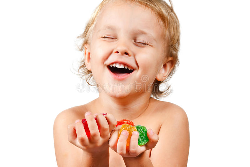 Little boy with colored jelly candies royalty free stock photo
