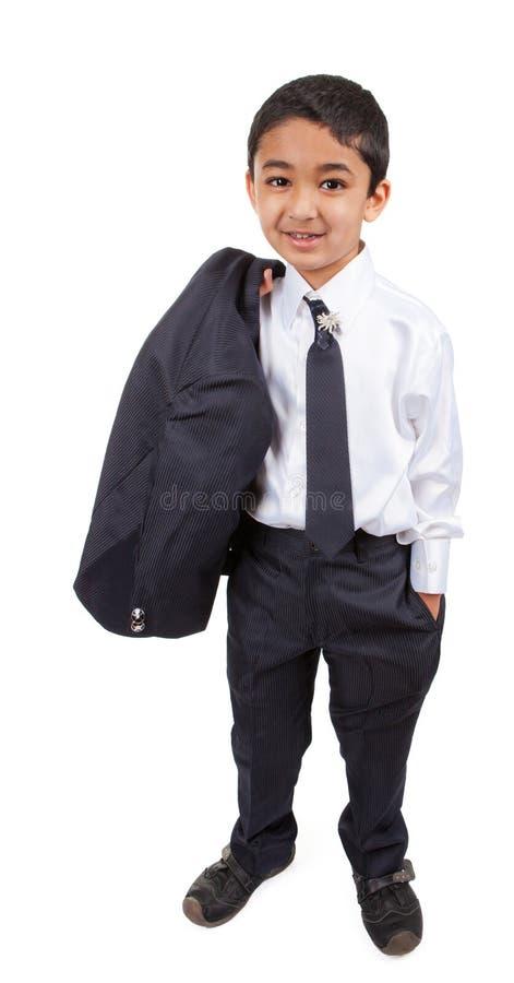 Little Boy considerável em um terno de negócio foto de stock