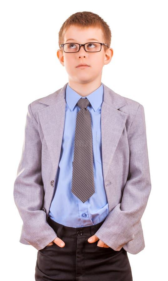 Little Boy considerável em um terno de negócio, isolado fotos de stock