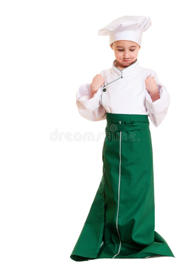 Little boy cookee in trying out stock photography