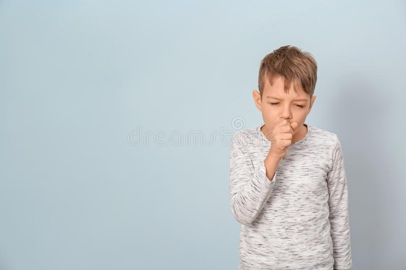 Little boy coughing stock images