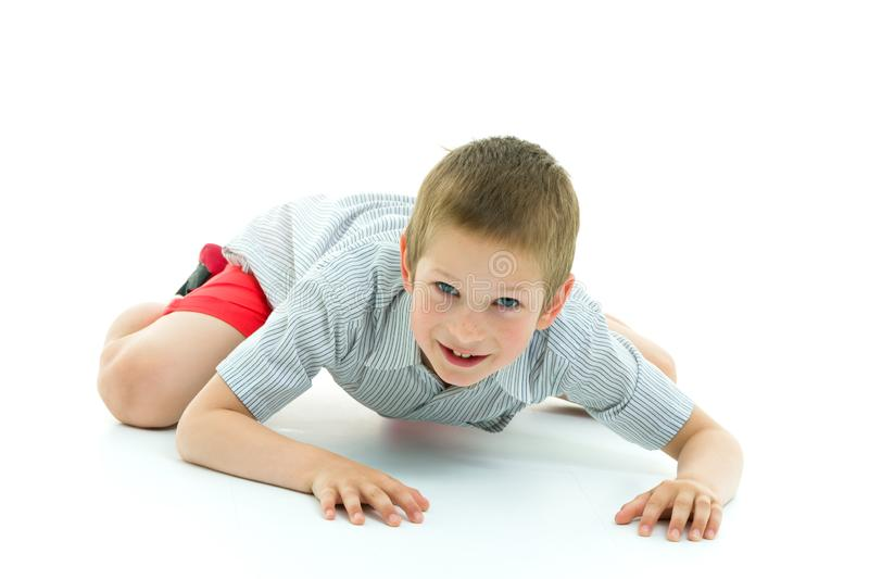 A little boy is crawling on the floor. The concept of children`s royalty free stock photography