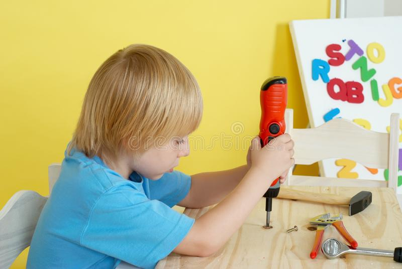 Download Little Boy On Creative Lesson Stock Image - Image of tool, argentinian: 10247005