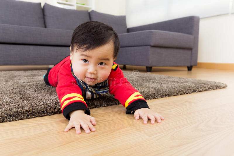 Little boy creeping on floor. At home royalty free stock photos