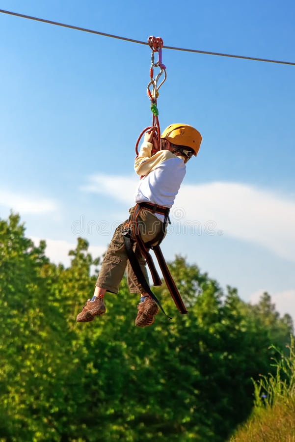 Download Little Boy Crossing Ravine On Rope Stock Image - Image: 14568095
