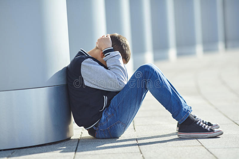 Little boy crying on the street stock images
