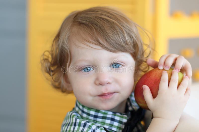 Hair Photos Boy Download: Little Boy With Curly Hair Holds Red Apple Stock Photo