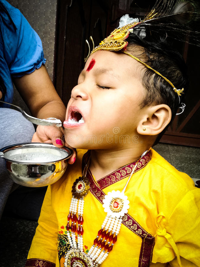 Little Boy Customed come Lord Krishna fotografie stock libere da diritti