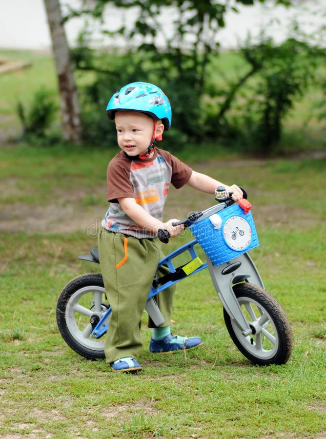 A little boy cycling on his first bike royalty free stock photo