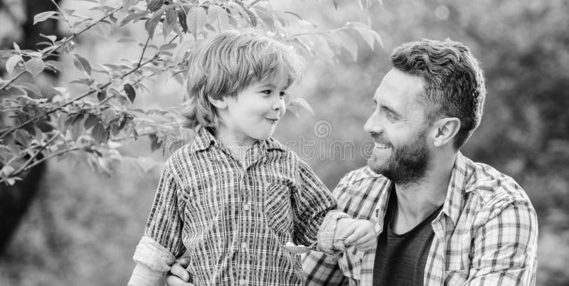 Little boy and dad eat. Everything is more fun with father. Organic nutrition. Healthy nutrition concept. Nutrition royalty free stock image